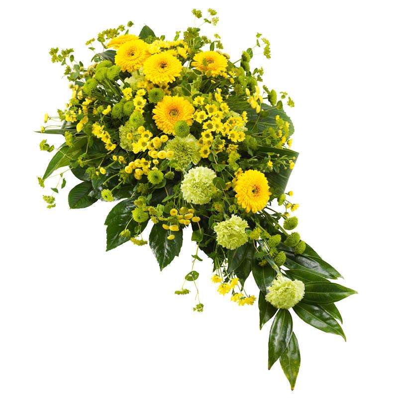 Sorgdekoration med blandade blommor i gult. Skicka den med ett blombud från Euroflorist - beställ enkelt online.