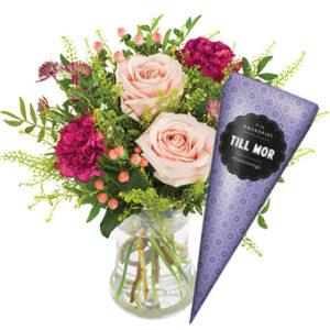 Bukett i rosa och lila plus en strut härliga chokladpraliner. Skicka med bud och gratta på Mors Dag! Ur Euroflorists sortiment.